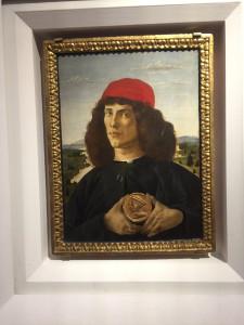 Botticelli - Portrait d'un jeune homme tenant un médaillon